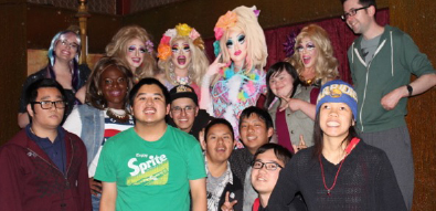 IMAGE: Group photo of the Happy Hour Crew and AccessSFUSD: The Arc in bright drag wigs and make-up. Left top: Bianca Hintermann, Jen Kabbabe, Linty (Linden Cady), Sara Sandoval, Heidi Seretan, Paul Ballard. Bottom Left: Brian Deng, Serena Jackson (DeMian Williams), Tommy Leung, Eduardo Ulloa, Armando Sanchez, Tony Wong, Koichi Koji, and Kacey Chui.